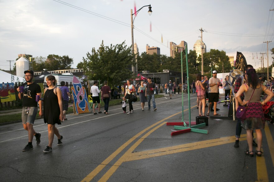 "People walk around the Independents' Day Festival on Sunday. Cameron Mitchell says Columbus has the reputation of being ""a smart, open, young, vibrant city."""