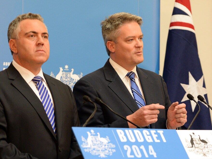 Australia's Finance Minister Mathias Cormann (right) speaks at a news conference as Treasurer Joe Hockey looks on in Canberra on Tuesday.