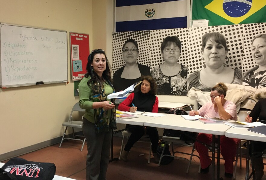 Liliana Reyes instructs a home health aide class on human biology at Encuentro, an immigrant education center in Albuquerque. State-certified graduates of the program help elderly and disabled clients with activities like bathing, dressing, and taking medication on time.