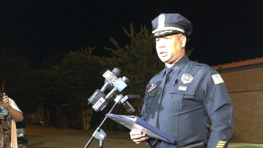 Memphis Police Director Michael Rallings speaks to reporters early Thursday in Memphis, Tenn., after armed officers and an angry crowd faced off late Wednesday night after officers with the U.S. Marshals Service shot and killed a man while trying to take him into custody.