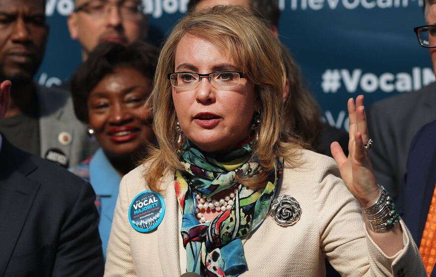 """Former Rep. Gabrielle Giffords says lawmakers should """"have some courage"""" and face their constituents at town halls, despite protests."""