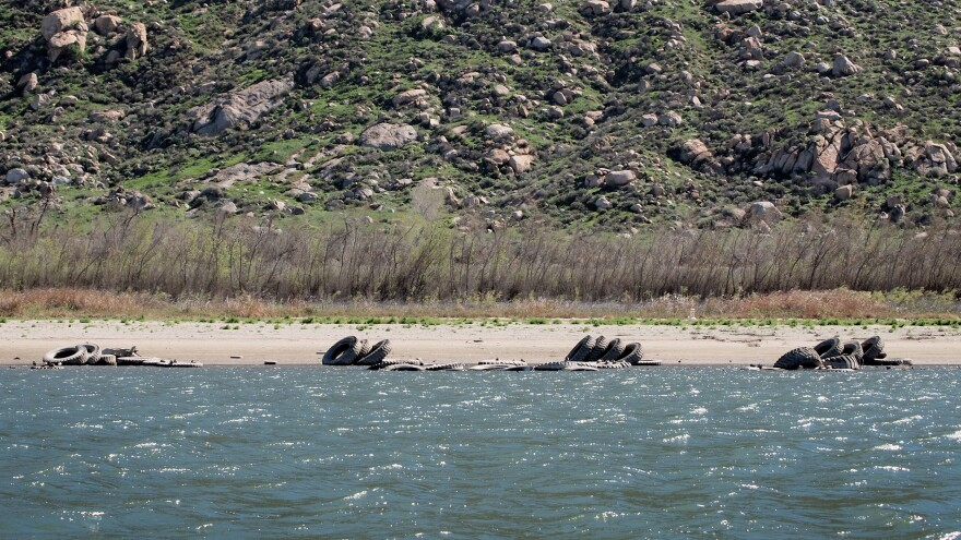 "Last fall, the drought revealed dozens of large tractor tires that had been submerged under the water of Lake Perris. The ""tire reef"" had been placed under the water in the 1970s as a fish habitat."