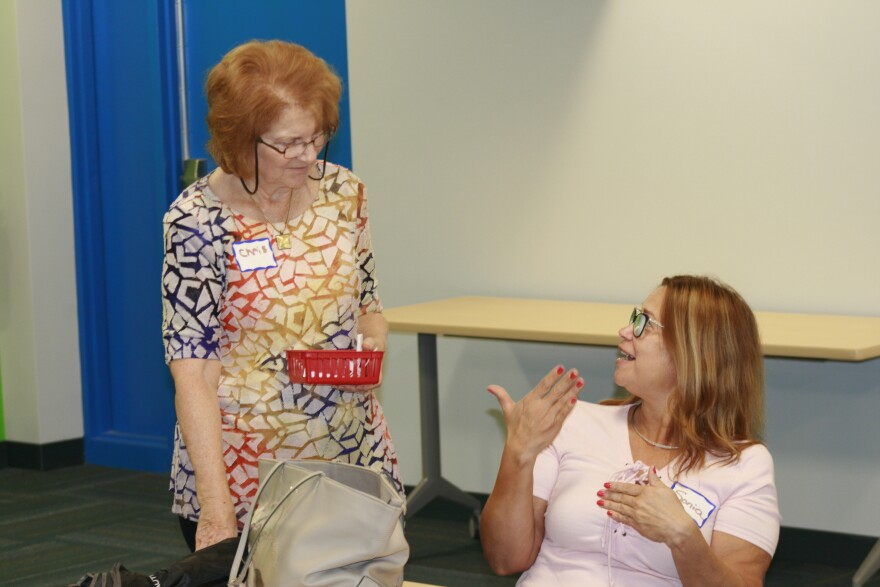 Two women talking. A tutor and student at an English Class at the Manatee Literacy Council.