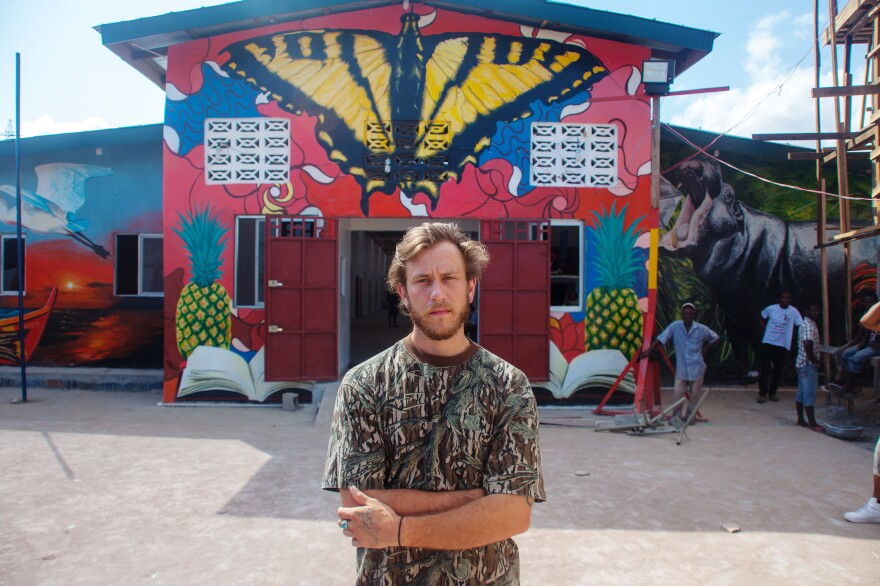 """David """"Nanook"""" Cogdill, an American street artist, came to Liberia to create a welcoming mural for a school that had been damaged by riots during the Ebola outbreak."""