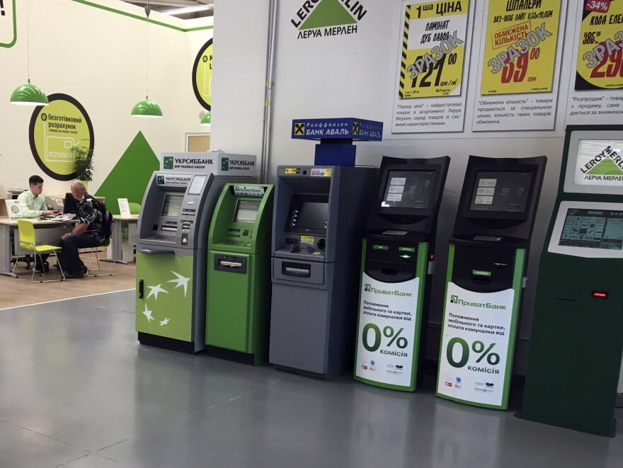 Cash machines in a supermarket in Kiev weren't working on Wednesday after a cyberattack paralyzed computers in Ukraine and elsewhere. Victims included government offices, energy companies, banks and gas stations.