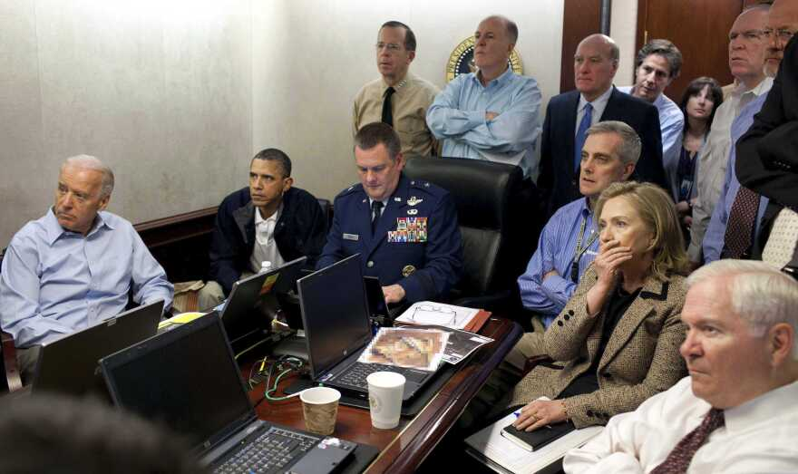 President Barack Obama and his top advisers receive an update in the White House Situation Room on the mission that killed Osama bin Laden in Pakistan in 2011. The National Geospatial-Intelligence Agency provided photos of bin Laden's compound, including the imagery in front of Secretary of State Hillary Clinton. The White House digitally altered those images before releasing this photo.