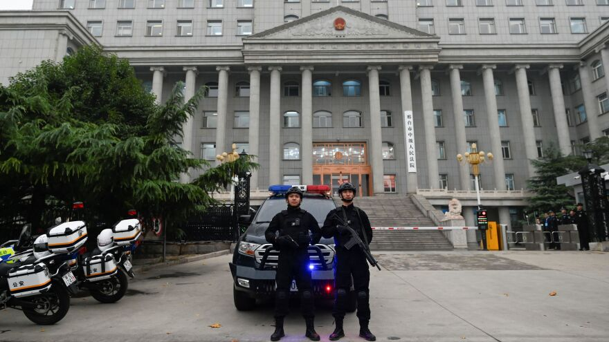 Police stand guard outside the Xingtai Intermediate People's Court in Xingtai, in China's Hebei province. The court issued stiff prison sentences to nine people caught in an illegal fentanyl ring.