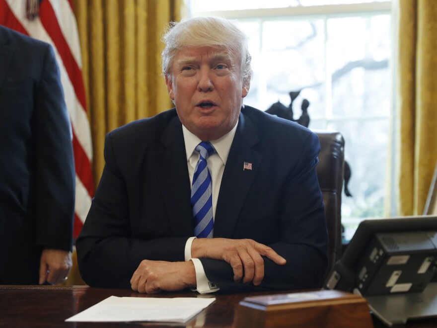President Trump speaks to the media in the Oval Office on Friday.
