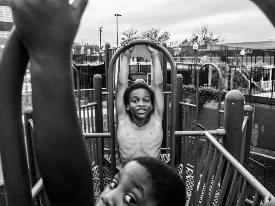 Dylan swings on a playground with his friend Sean Brown in 2016.
