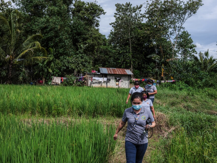 Marissa Tuping, a rural midwife and health-care worker, walks to visit pregnant mothers in the village of Abinganan.