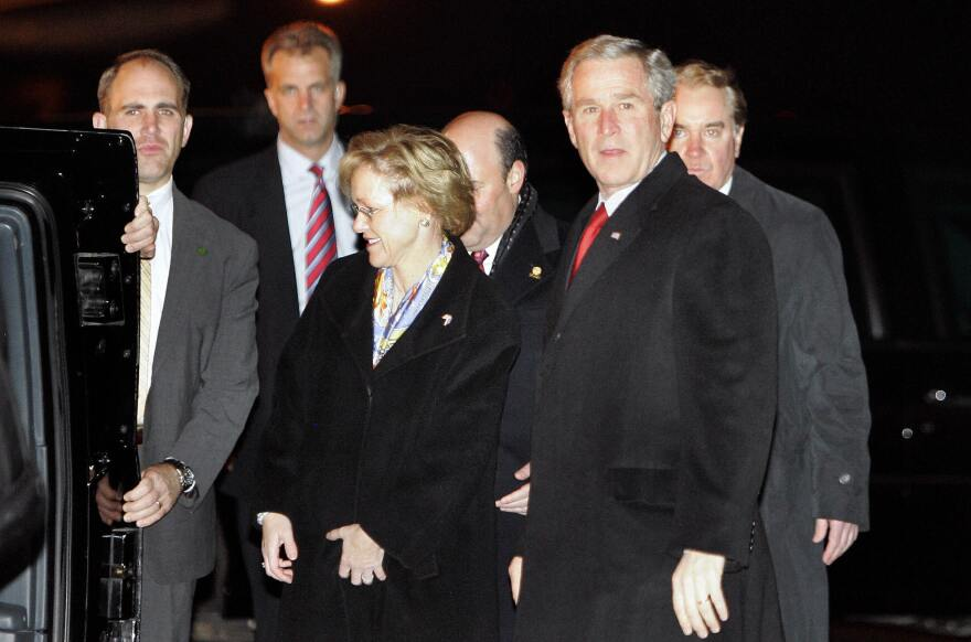 Then-President George W. Bush stands beside Aldona Wos upon arriving at the airport in Tallinn, Estonia, in November 2006. Wos, DeJoy's wife, was the U.S. ambassador to Estonia at that time.