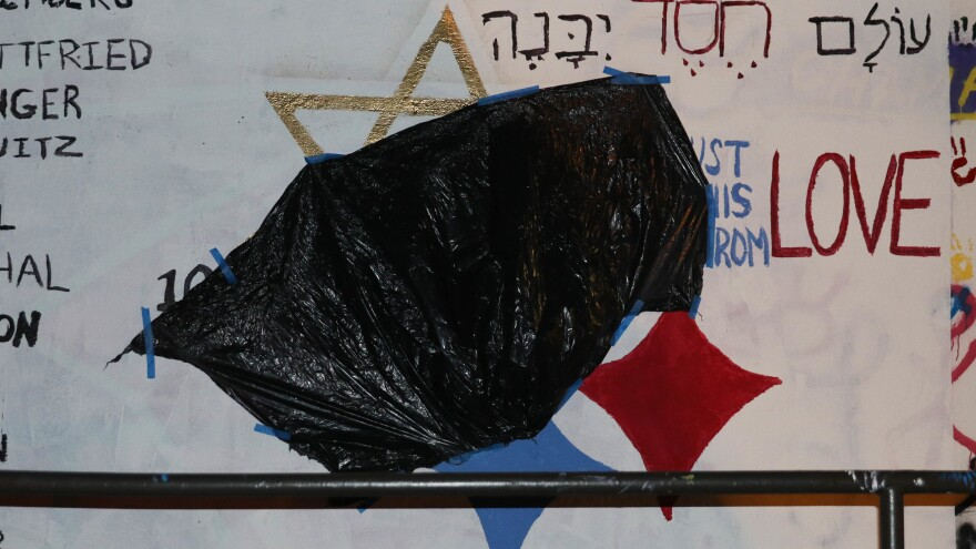 "A black trash bag covers a red swastika painted over a mural at Duke University. Dedicated to the victims of the Pittsburgh synagogue shooting, the original mural replaced the yellow star in the Pittsburgh Steelers' emblem with the Star of David and read, ""We must build this world from love."""