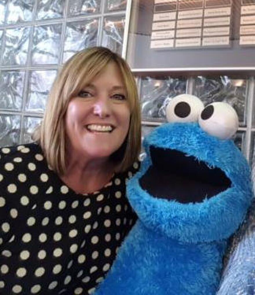 Kitty Lensman and Cookie Monster. Lensman will become the new president and CEO of Public Media Connect on July 1.