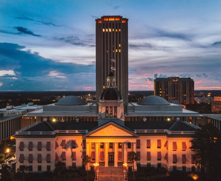 Florida Capital.jpg Florida's Historic Capital building glows orange at night. The new Capital building rises behind it as the sunset fades.