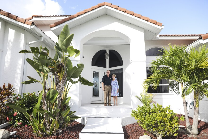 John and Mary Jane Forr stand outside their home in Punta Gorda, Fla. Forr, a retired Marine Corps colonel, discovered he could save $2,500 a year by shopping around for a lower-rate mortgage.