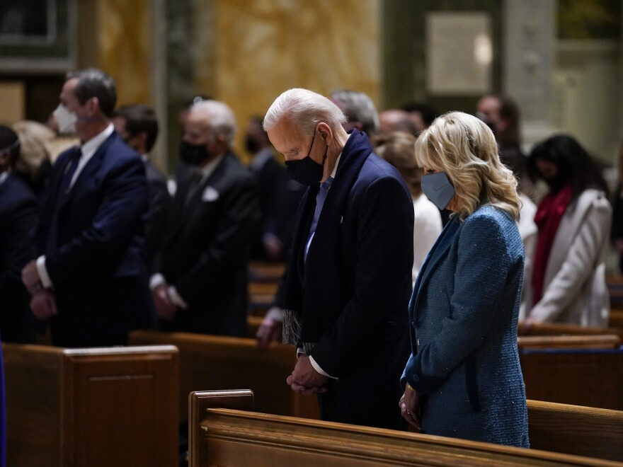 President-elect Joe Biden and his wife, Jill Biden, attend Mass at the Cathedral of St. Matthew the Apostle ahead of his inauguration as the nation's 46th president on Jan. 20, 2021.