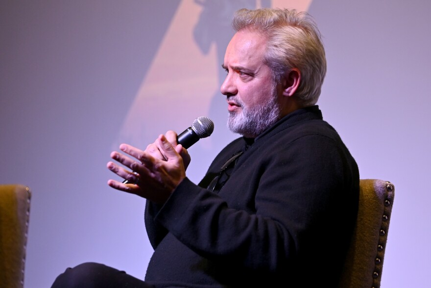 Sam Mendes speaks onstage at a special screening of <em>1917</em> earlier in December.