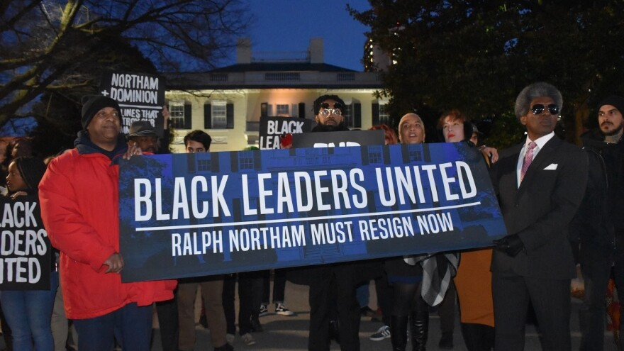 Protesters stand outside Virginia's Executive Mansion in February.