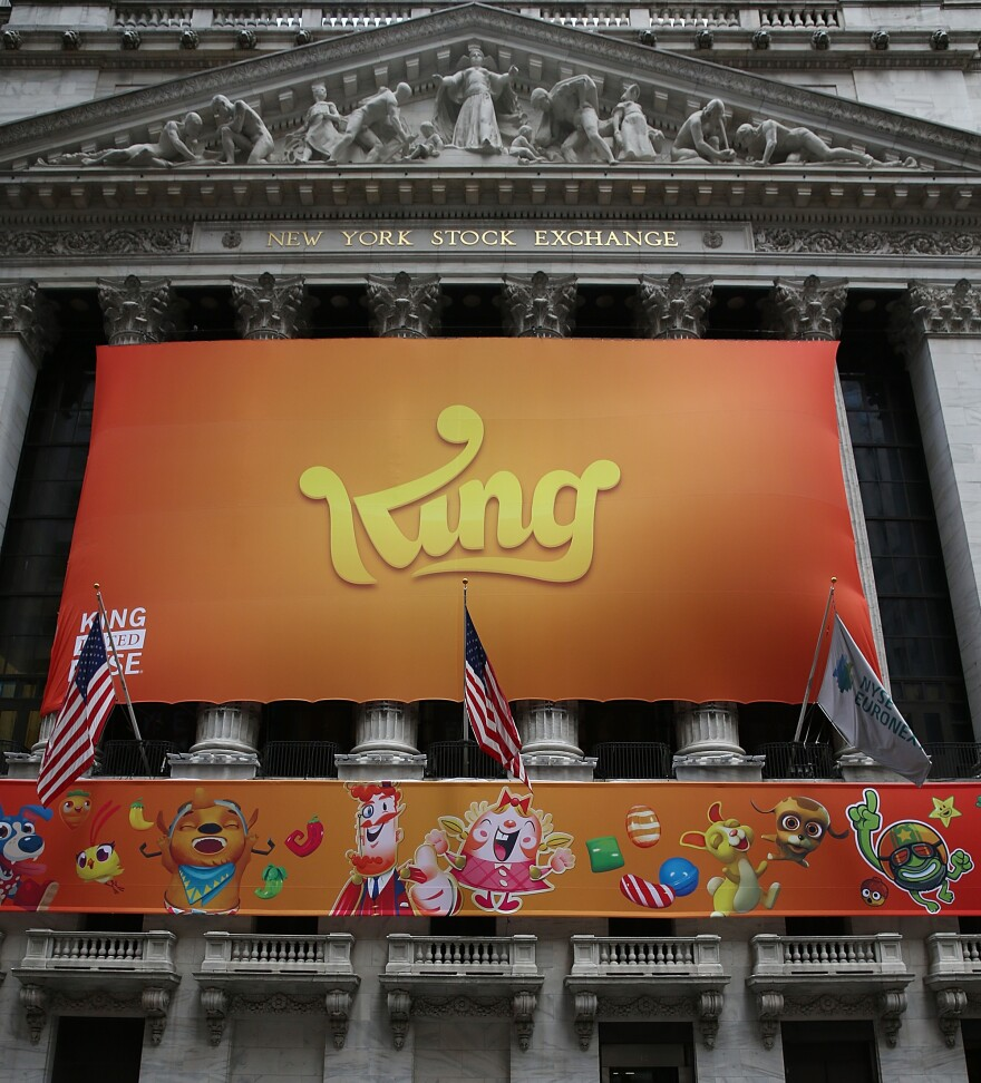 A banner for the mobile gaming company King Digital Entertainment is seen outside the New York Stock Exchange during King's initial public offering.
