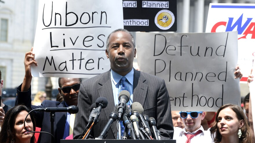 Republican presidential candidate Ben Carson spoke at an anti-abortion rally opposing federal funding for Planned Parenthood at the U.S. Capitol on Tuesday.