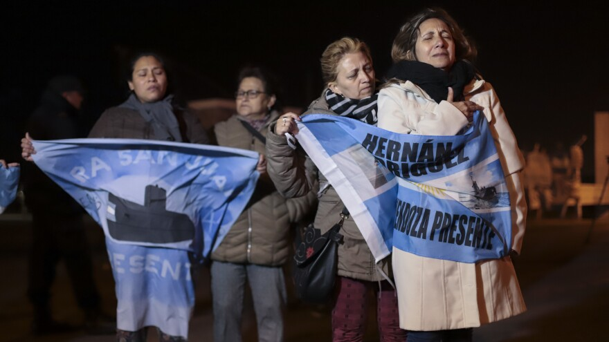 Relatives of crew members on board the ARA San Juan submarine wait outside the navy base in Mar del Plata. Argentina's navy announced early Saturday the missing submarine has been located in a deep ravine in the Atlantic Ocean.