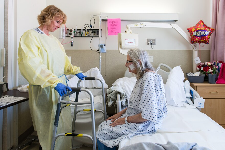 Nurse specialist Annelie Nilsson checks on patient Janet Prochazka during her stay at the Zuckerberg San Francisco General Hospital, after Prochazka took a bad fall in March.