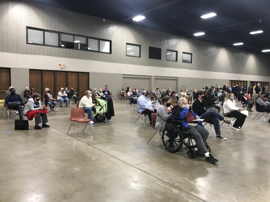 People wait for a dose of the COVID-19 vaccine at the Esports Stadium Arlington & Expo Center. The center has been transformed into a mass vaccination site for residents of Tarrant County and beyond.