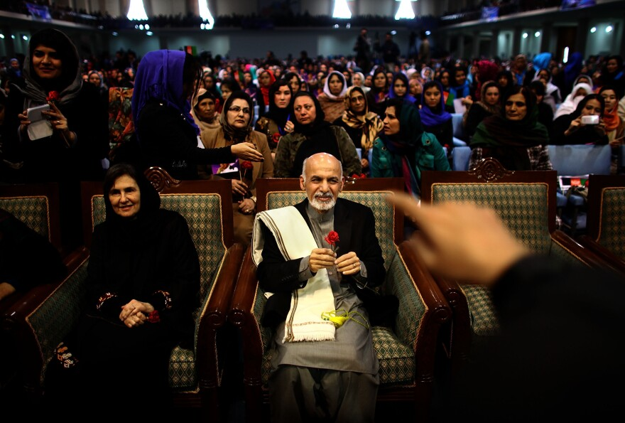 Then-presidential candidate Ashraf Ghani sits next to his wife, Rula, during a campaign rally in Kabul on March 9, 2014. In an unusual move for Afghan politics, Ghani's wife spoke during the rally — a foreshadowing of her role in her husband's presidency.
