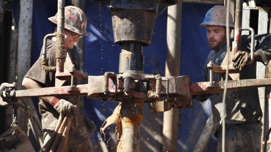 """Oil field workers drill into the Gypsum Hills near Medicine Lodge, Kan. Hydraulic fracturing, or """"fracking,"""" to coax out oil and gas has led to a natural gas boom, but some remain concerned of the potential environmental impact."""