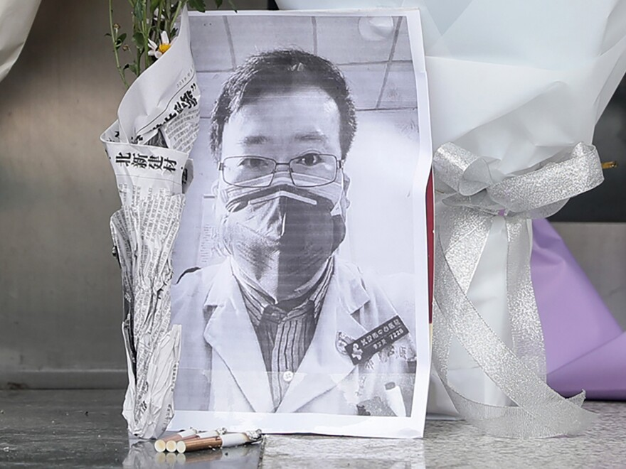 A photo of the late ophthalmologist Li Wenliang at a hospital in Wuhan, China, on Friday. Li, who is being hailed for his efforts to alert the medical profession to the new virus, died Friday after becoming infected.