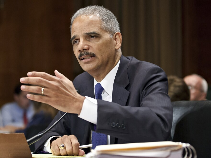 Former Attorney General Eric Holder testifies on Capitol Hill in Washington in June 2012. Holder, now in private practice, has signed on to represent the California Legislature as outside legal counsel.