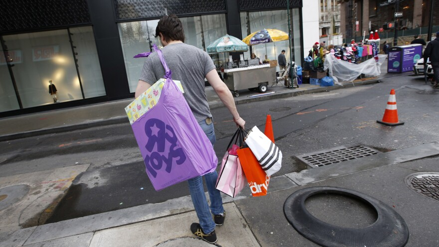 Retailers expect a strong increase in holiday shopping this year and hope not to see unseasonably warm weather like last year's, which cut into sales and had this man in New York shopping in shirtsleeves.