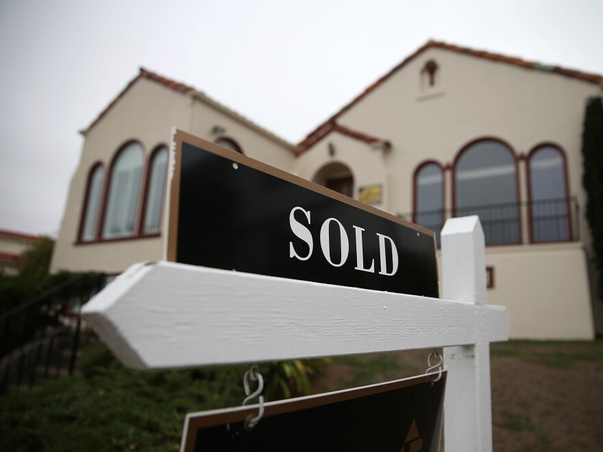 Sales of previously owned homes jumped more than 20% in September from a year earlier, but sales of homes costing more than $1 million more than doubled.