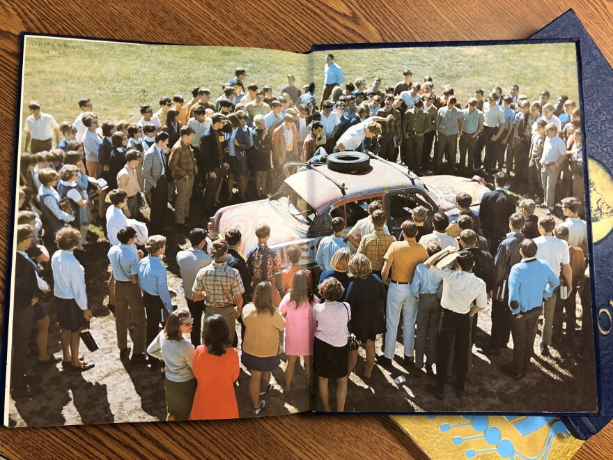 Gilbert Baker yearbook color spread crowd with car.jpg
