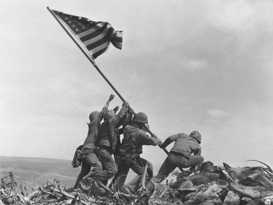 Marines of the 28th Regiment, 5th Division raise the U.S. flag atop Mount Suribachi on Iwo Jima on Feb. 23, 1945. After more than seven decades, Navy Corpsman John Bradley's name will be replaced in captions with the name of Pvt. 1st Class Harold Schultz.