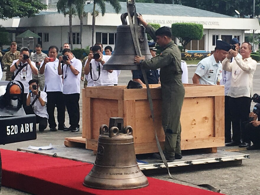 The Balangiga church bells are unloaded in Manila after being in U.S. possession for 117 years.