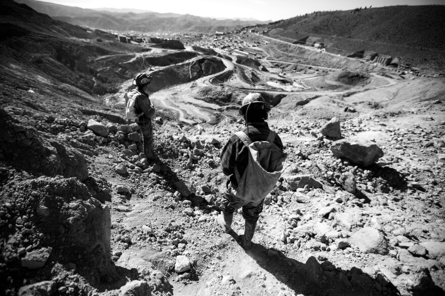 "Young miners head home after working inside Cerro Rico. In Potosí, Marston says children often attend school while also working in the mines. ""They go underground in the morning and night, then they go to school in the day,"" says Marston. She says some children work in the mines ""because they have a father who has been killed, and they need money."""