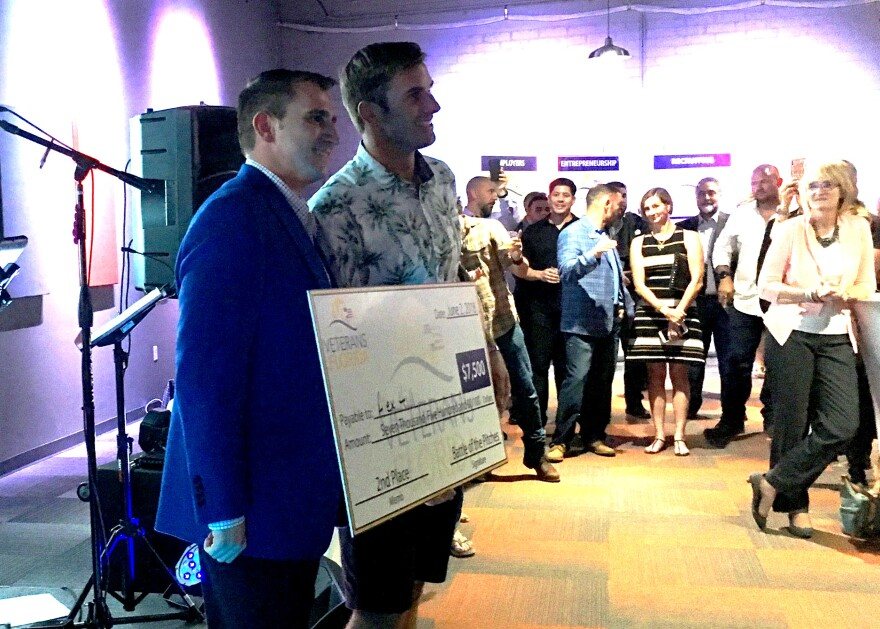 alex_hill_accepts_his__7_500_second_place_prize_at_the_2018_veterans_florida_battle_of_the_pitches..jpg