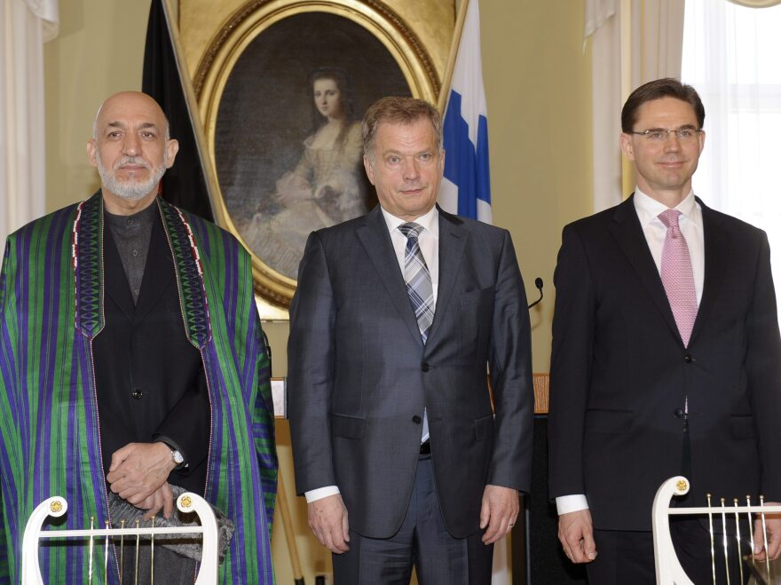 Afghan President Hamid Karzai with Finnish President Sauli Niinisto (center) and Finnish Prime Minister Jyrki Katainen on Monday.