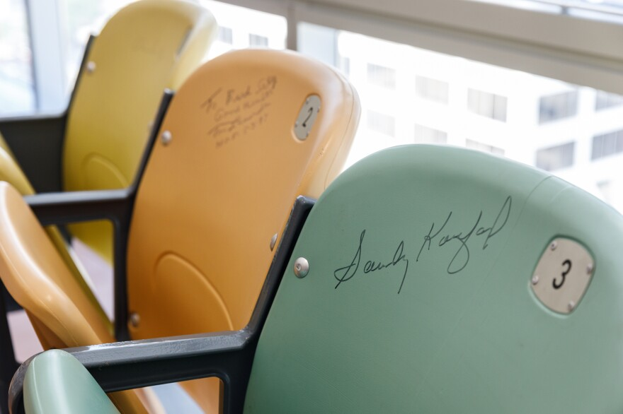 A row of autographed chairs from Dodger Stadium sits in Selig's office. The signatures include long-time manager Tommy Lasorda, Hall-of-Fame pitcher Sandy Koufax, broadcaster Vin Scully.