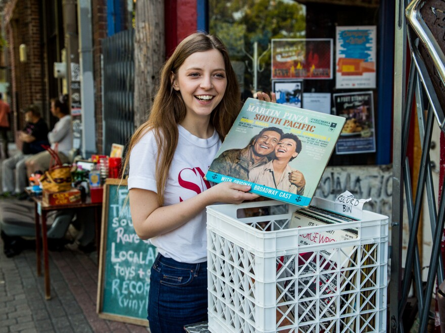 Jade Bird shuffles through a record bin in Deep Ellum, Dallas.