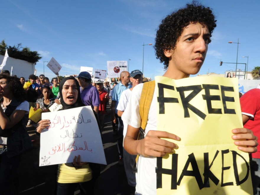 Young protesters in Rabat, Morocco, demand political and social changes along with the release of jailed rapper Mouad Belrhouate on Sept. 11, 2011.
