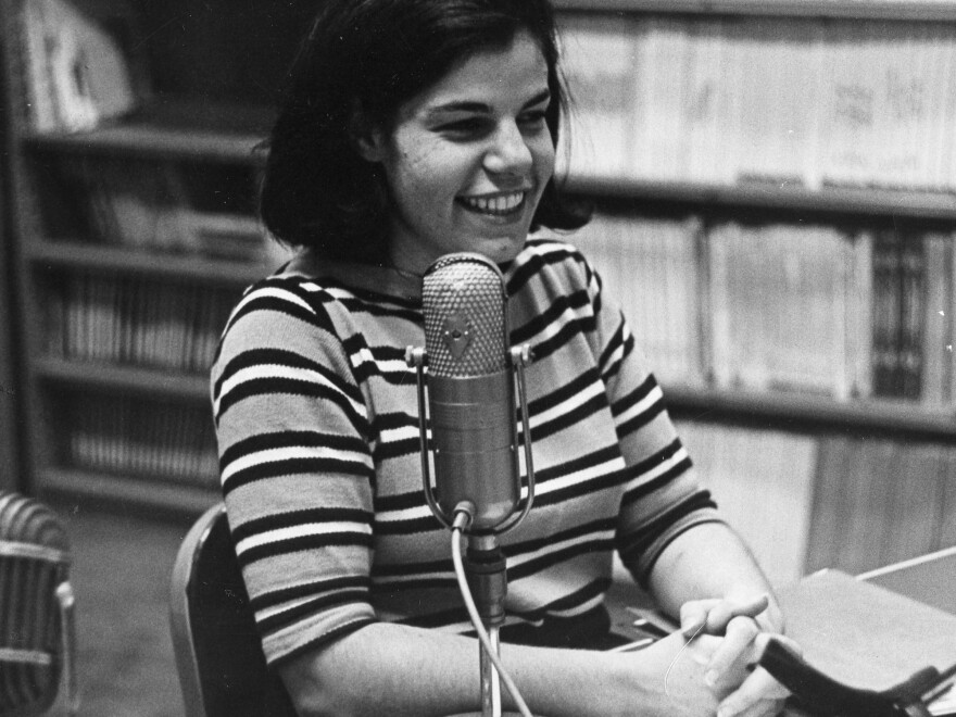 The earliest photo of Susan Stamberg at a microphone, age 25. Later, as the host of <em>All Things Considered,</em> she was the first woman to be a full-time anchor of a U.S. national nightly news broadcast.