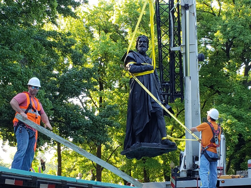 Crews lift the Christopher Columbus statue from its pedestal in Tower Grove Park on June 16, 2020.