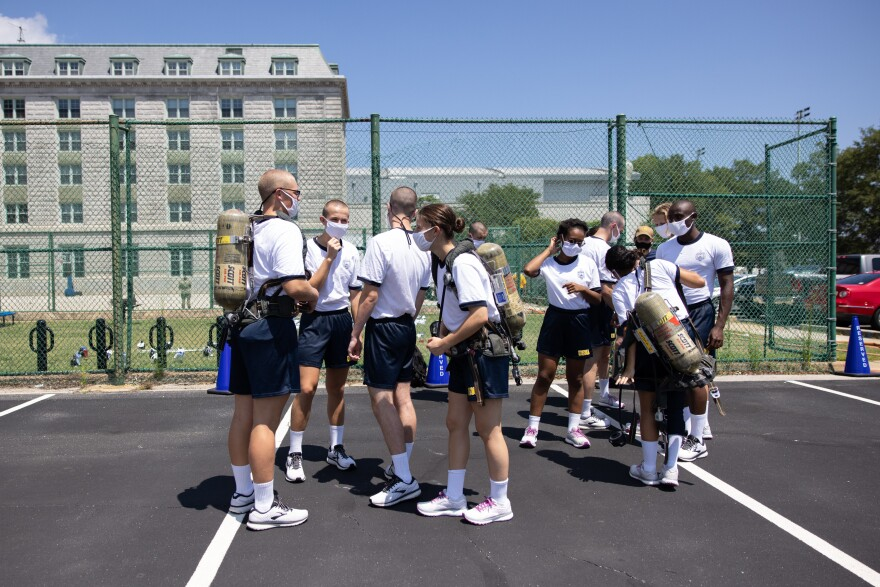 Midshipmen participate in fire safety training on campus in Annapolis.