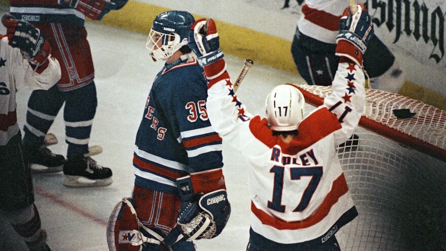 Washington Capitals center Mike Ridley celebrates his teammate Rod Langway's game-winning overtime goal against the New York Rangers in 1990. Later in the series, the Capitals would win again in overtime to take series and go to the Eastern Conference finals — and announcer Ron Weber was there for the famous call.