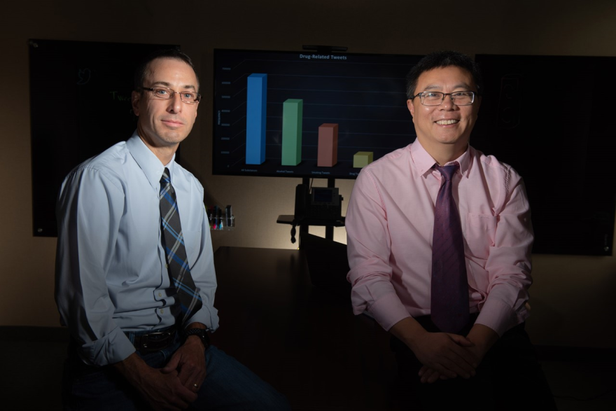 A photo of professor Dr.Deric Kenne (left) and Dr.Ruoming Jin (right).