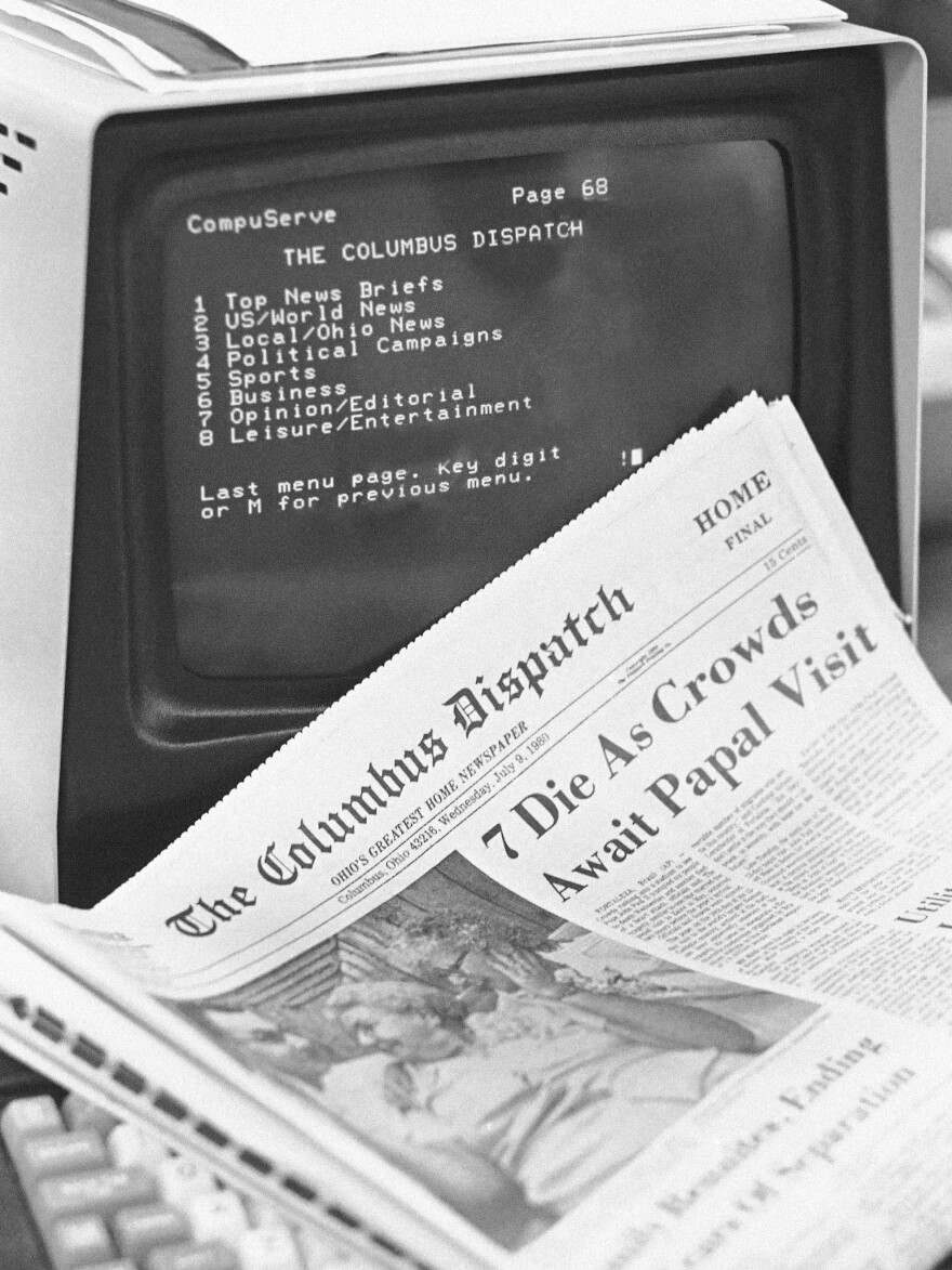A CompuServe system shows an index of stories by the Columbus Dispatch and Associated Press on July 9, 1980.