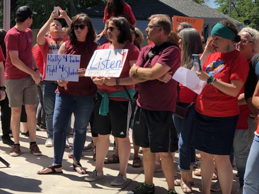 Salt Lake City teachers hold signs