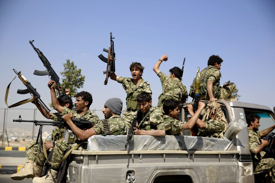 Shiite fighters, known as Houthis, ride on a patrol truck as they chant slogans during a tribal gathering showing support for the Houthi movement in Sanaa, Yemen, on Monday.